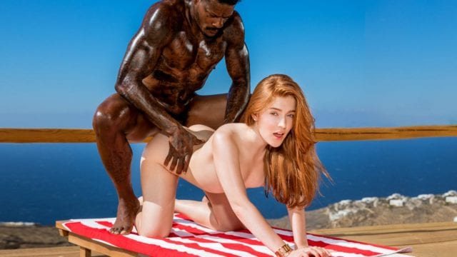 Young rich redhead with a black dick by the pool